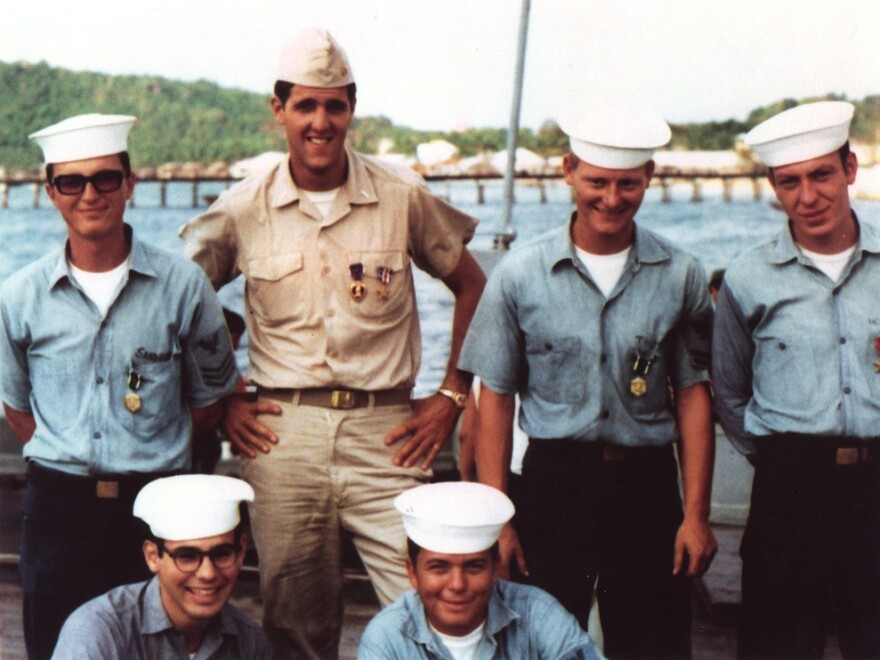 Future U.S. senator and presidential candidate John Kerry poses with crewmates during the Vietnam War in this file photo. An attack on his service by a group calling itself the Swift Boat Veterans for Truth is remembered as a turning point in the 2004 election. But political scientists say negative ads might not be that effective.