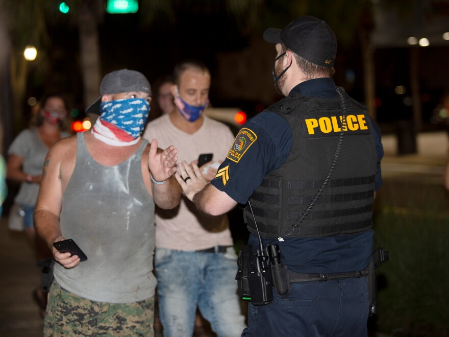 A New Port Richey police officer talks with counterprotesters at a recent Black Lives Matter demonstration downtown. He was stopping them from following activists as they marched down the block.