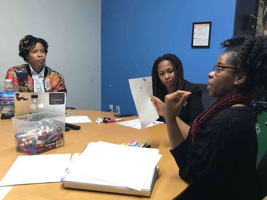 Charli Cooksey (left), founder and CEO of WEPOWER, listens to entrepreneurs Reina Stovall (right) and Dr. Brittany Conners (middle) during one of Elevate/Elevar's focus group meetings on March 13, 2019.
