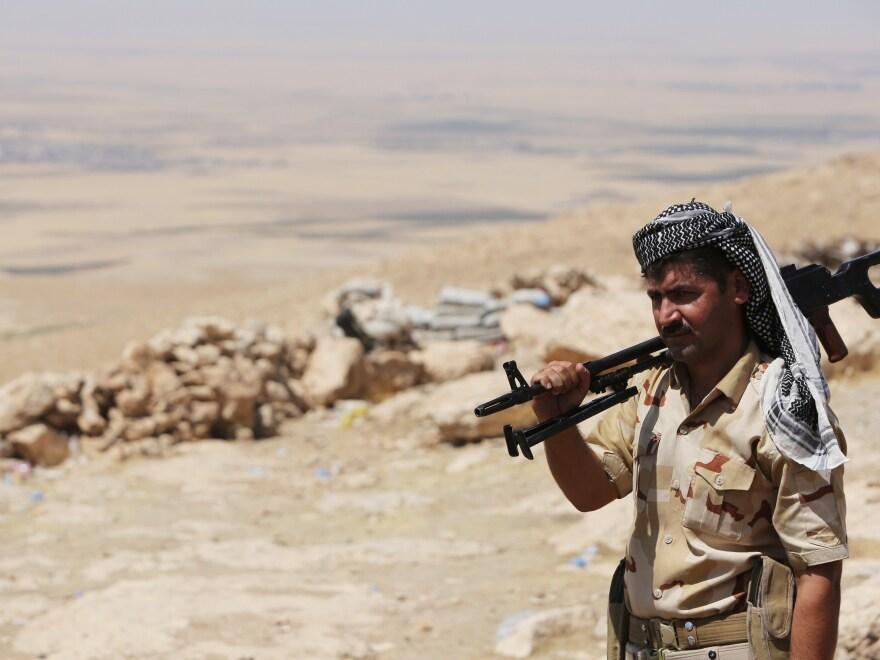 A Kurdish Peshmerga fighter on the front line in Bashiqa, a village near Mosul.