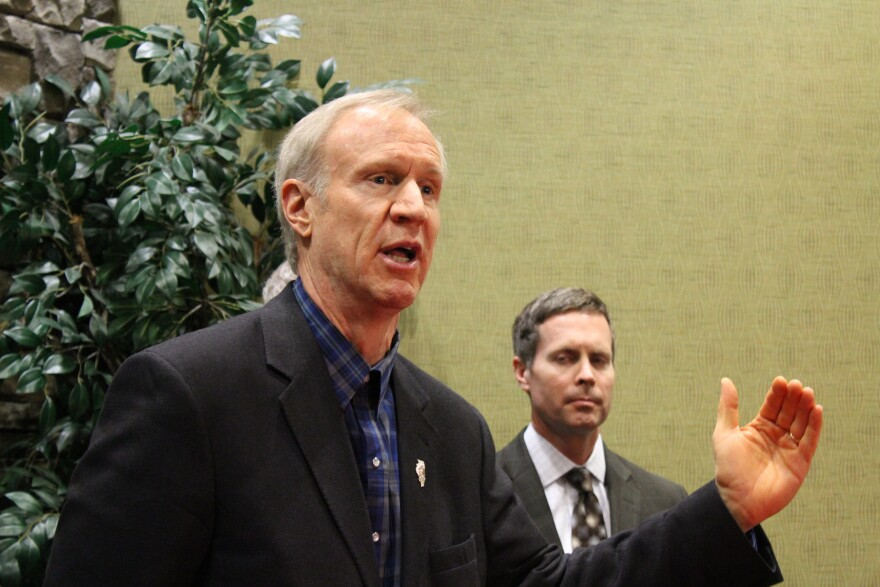 Illinois Gov. Bruce Rauner talks with reporters in O'Fallon, Illinois. Rauner expressed enthusastic support for bringing the NGA headquarters to the Metro East.
