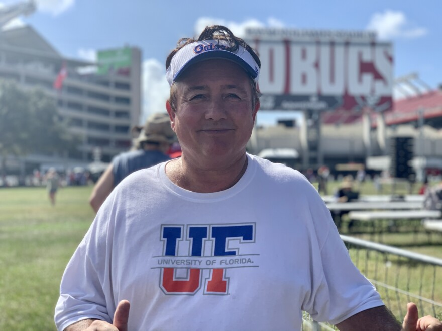 Man with University of Florida hat and t-shirt outside