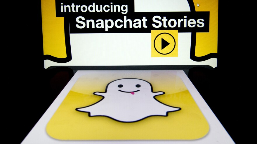 """The logo and a page of mobile app """"Snapchat"""" are displayed on tablets. Hackers broke into Snapchat, the popular mobile app, accessing the phone numbers and usernames of 4.6 million users and publishing them online."""