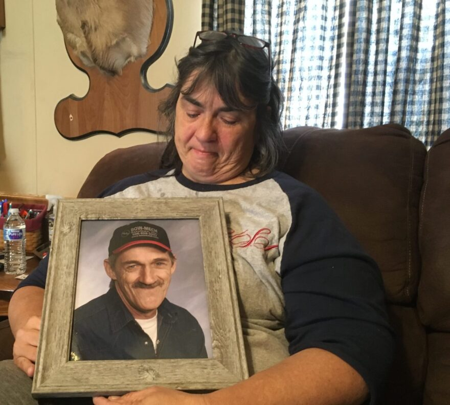 Vickie Salyers with a picture of Gene, who died in 2013.
