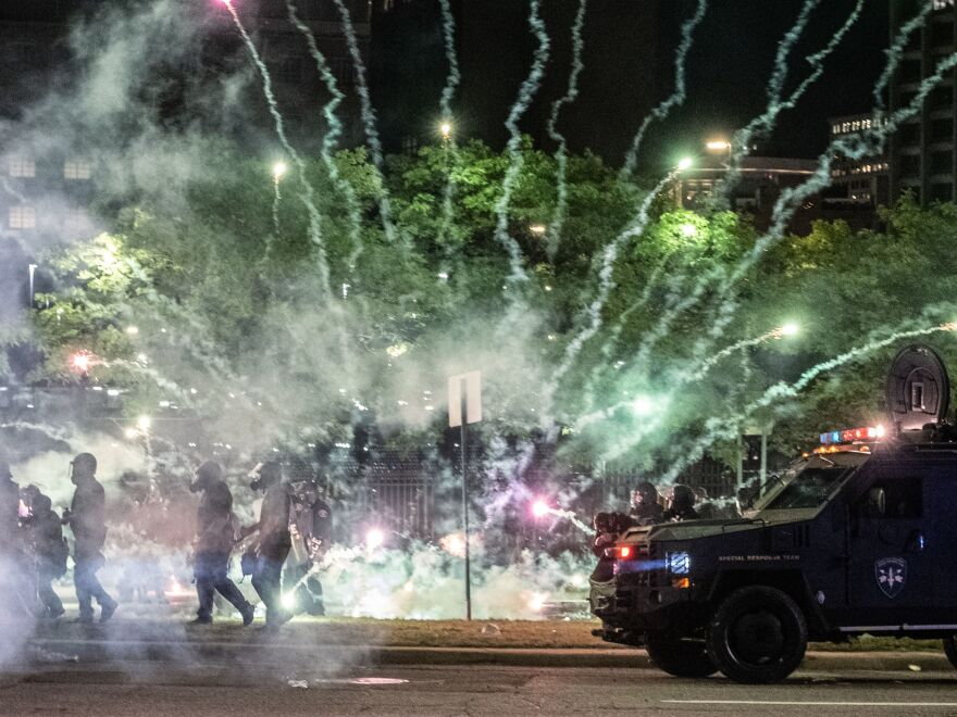 "After covering anti-police brutality protests in May, photojournalists Nicole Hester, Matthew Hatcher and Seth Herald (who took this photo) were shot with rubber pellets by Detroit Police Cpl. Daniel Debono in an ""unprovoked"" attack, according to prosecutors. Debono faces three counts of felonious assault."