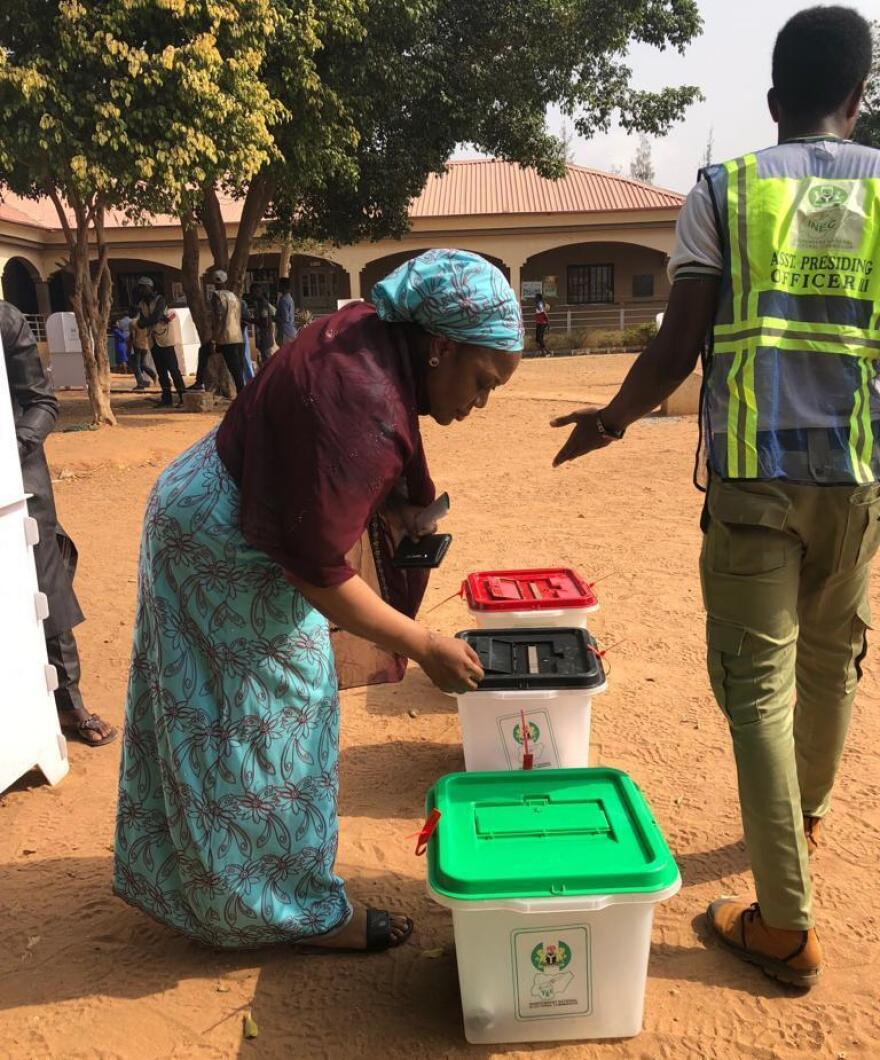 Ruka Ajana casts her ballot at a polling station in Abuja, Nigeria's capital.