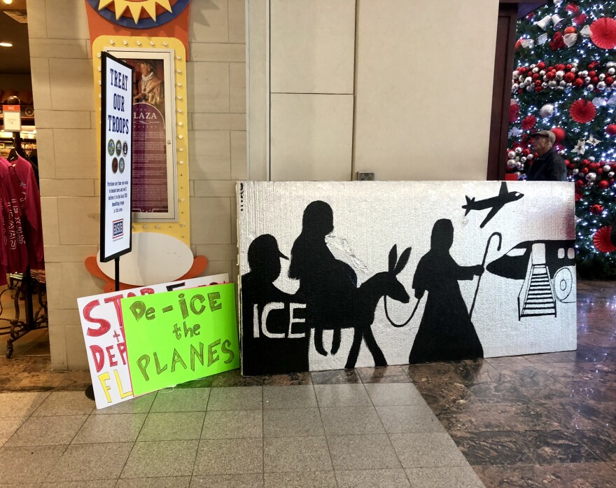 Protest signs at the El Paso airport.