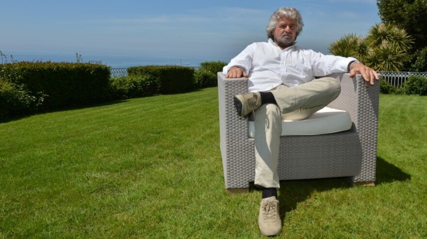 Italian comedian Beppe Grillo poses during an interview at his home in Genoa.