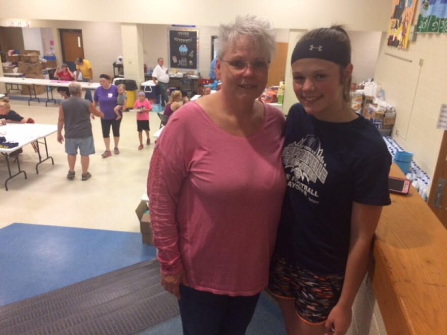Flood relief volunteers Beverly VanScyoc and her daughter Madeline at Hundred High School.