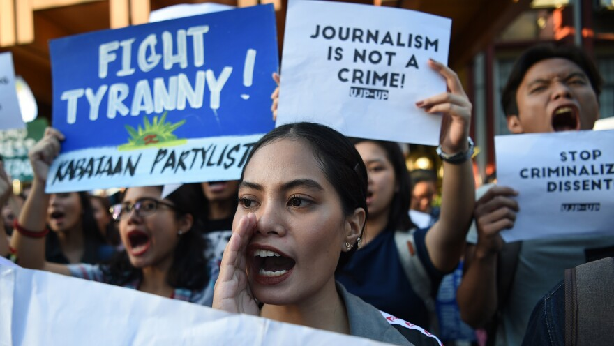 Students hold placards as they shout slogans during a protest at the state university in Manila, Philippines, on Thursday in support of Rappler CEO Maria Ressa, who was arrested a day earlier.