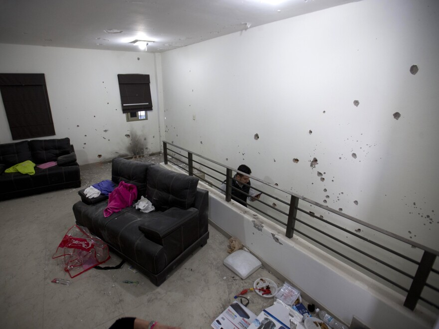 "Bullet holes riddle the walls of the second floor of the home that marines raided in their search for the Mexican drug lord Joaquin ""El Chapo"" Guzmán."