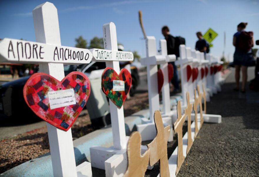 Crosses memorialize the victims of a mass shooting, which left at least 22 people dead, in El Paso, Texas. It was one of cluster of shootings that took place in roughly a week.