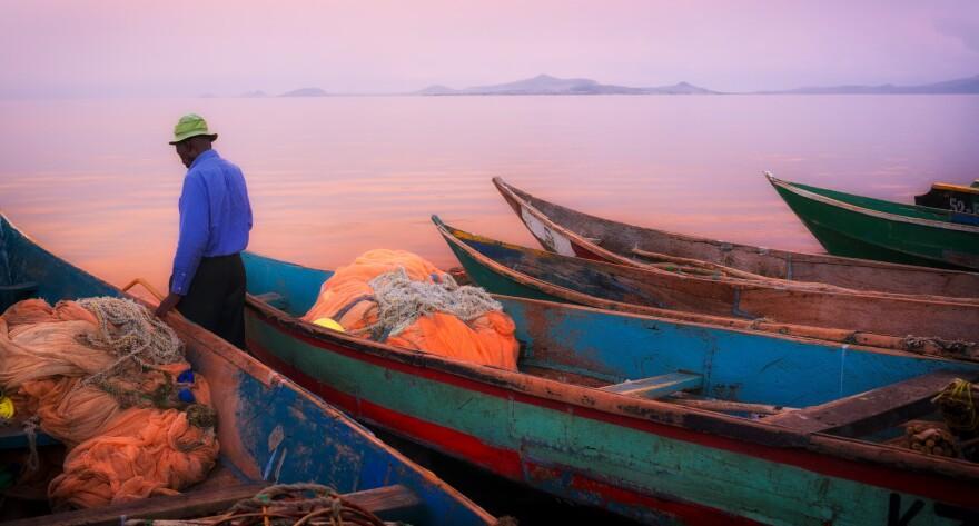 Fishing boats at sunset on Lake Victoria. They're docked on Kenya's Mfangano Island.