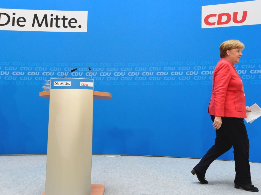 German Chancellor Angela Merkel leaves a press conference after a leadership meeting at her party headquarters in Berlin on Monday. Hardliners in her conservative bloc want to bar asylum-seekers from entering Germany if they've already applied or registered for asylum in other European countries.