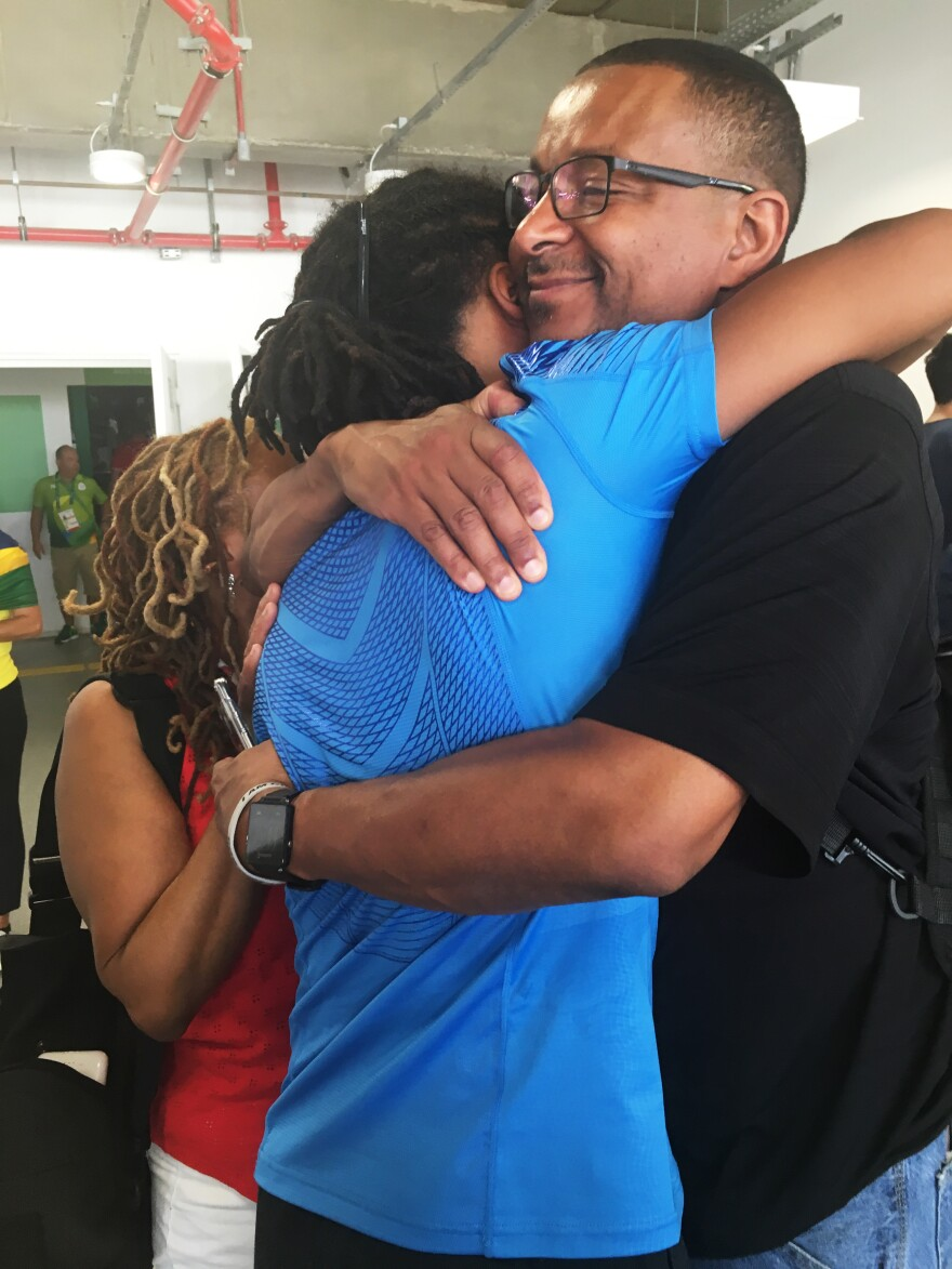 """Jason Pryor hugs his father, Eric, after his match on Tuesday. """"This isn't the end,"""" Jason says. """"This is simply one competition."""""""