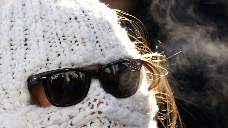 Julie Caruso of Akron, Ohio, was wrapped up Tuesday as she waited in line for a White House tour. It was well below freezing in the nation's capital. Temperatures were even lower in other parts of the nation.