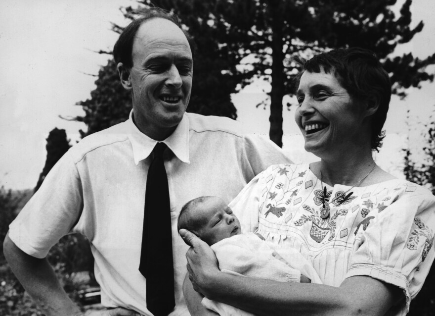 Author Roald Dahl stands with his wife, American actress Patricia Neal, and their newborn daughter, Lucy, outside their home in Buckinghamshire, England, in August 1965. Roald Dahl died in 1990.