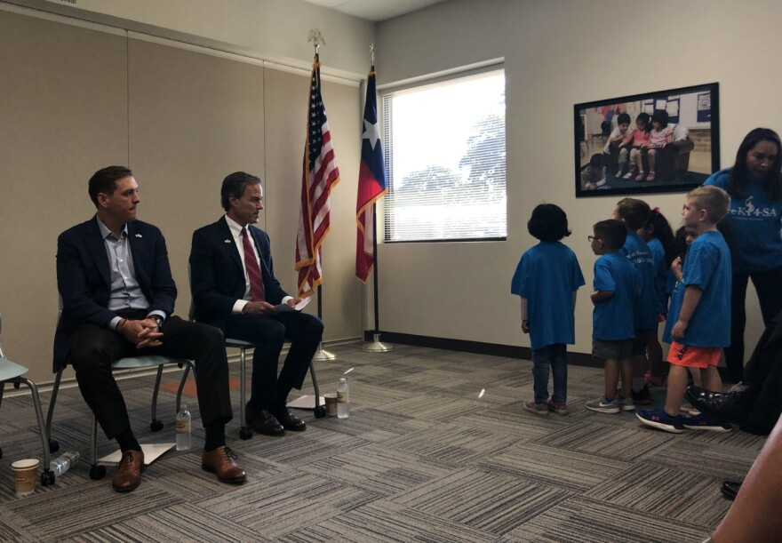 HOLT CAT CEO Peter J. Holt, left, and former Texas Speaker of the House Joe Straus watch students at the Pre-K 4 SA North Education Center say the pledge of allegience during a news conference announcing their effort to extend funding for Pre-K 4 SA.