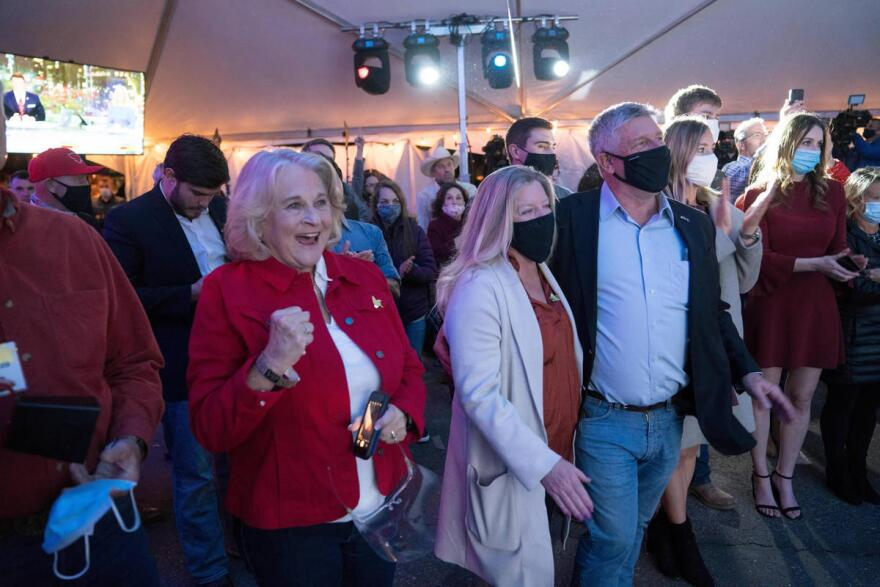 Supporters look on as Greg Gianforte speaks in an open-air tent outside Hilton Garden Inn in Bozeman, shortly after the AP called the governor's race in his favor, Nov. 03, 2020.