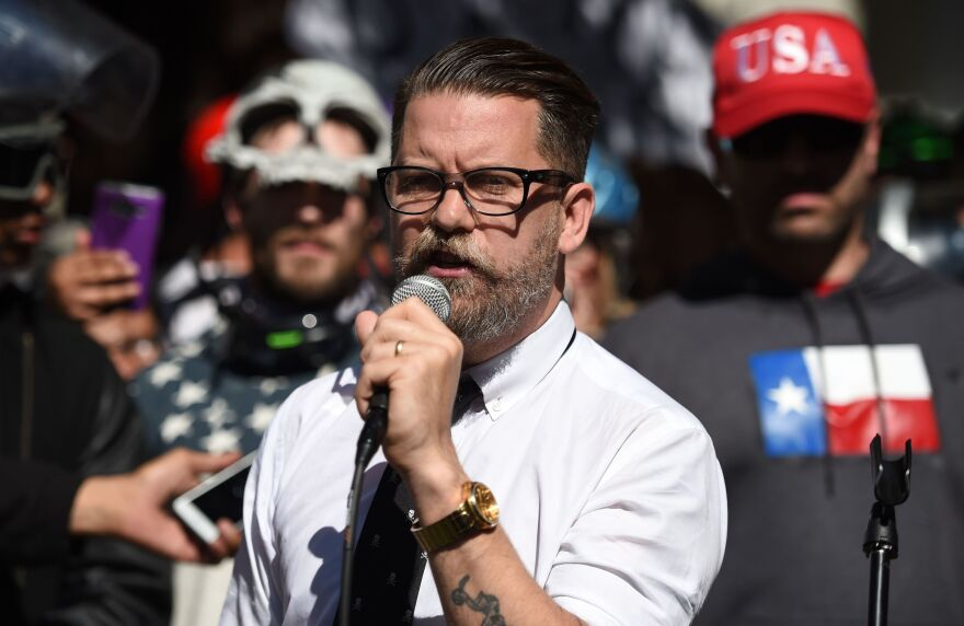 Conservative speaker and Vice Media co-founder Gavin McInnes reads a speech written by conservative commentator Ann Coulter to a crowd during a rally in Berkeley, Calif., in 2017.