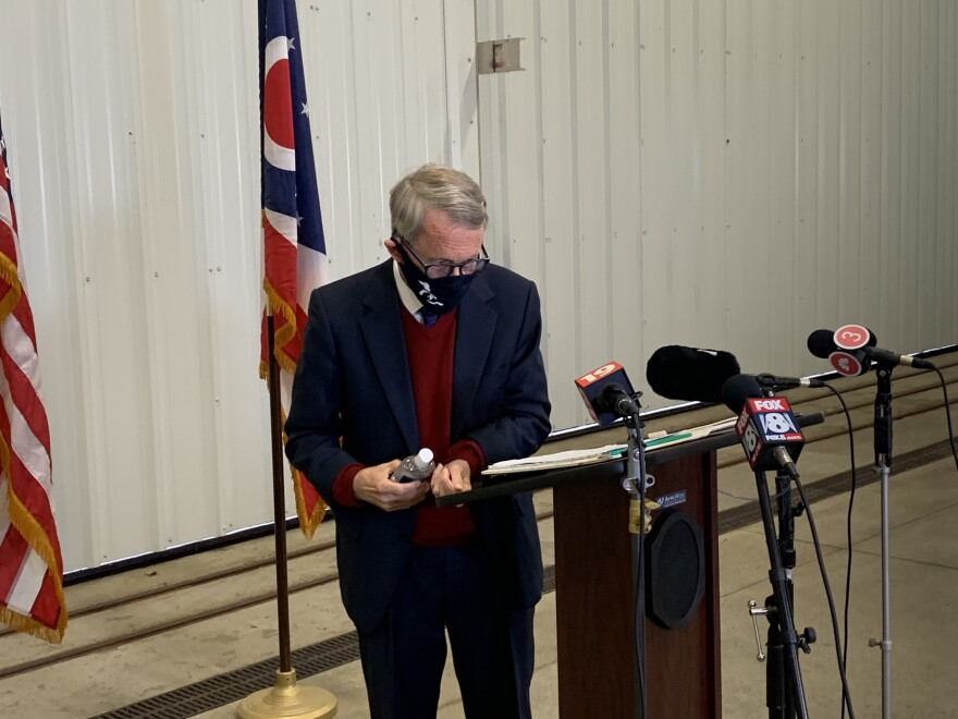 Gov. Mike DeWine uses hand sanitizer while at Burke Lakefront Airport
