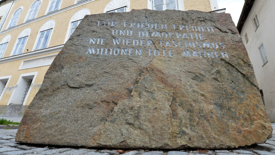A memorial stone outside Adolf Hitler's birthplace reading 'For peace, freedom and democracy. Never again fascism. Millions dead are a warning.'