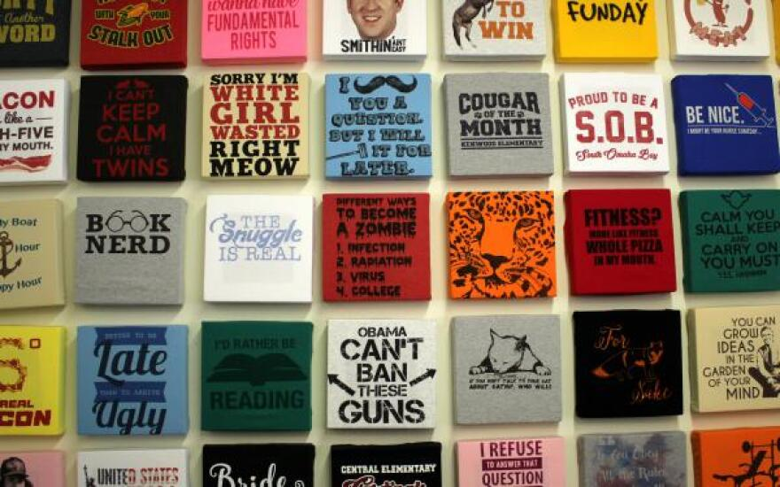 This wall of shirts at 24 Hour Tees shows off some of the business' designs.