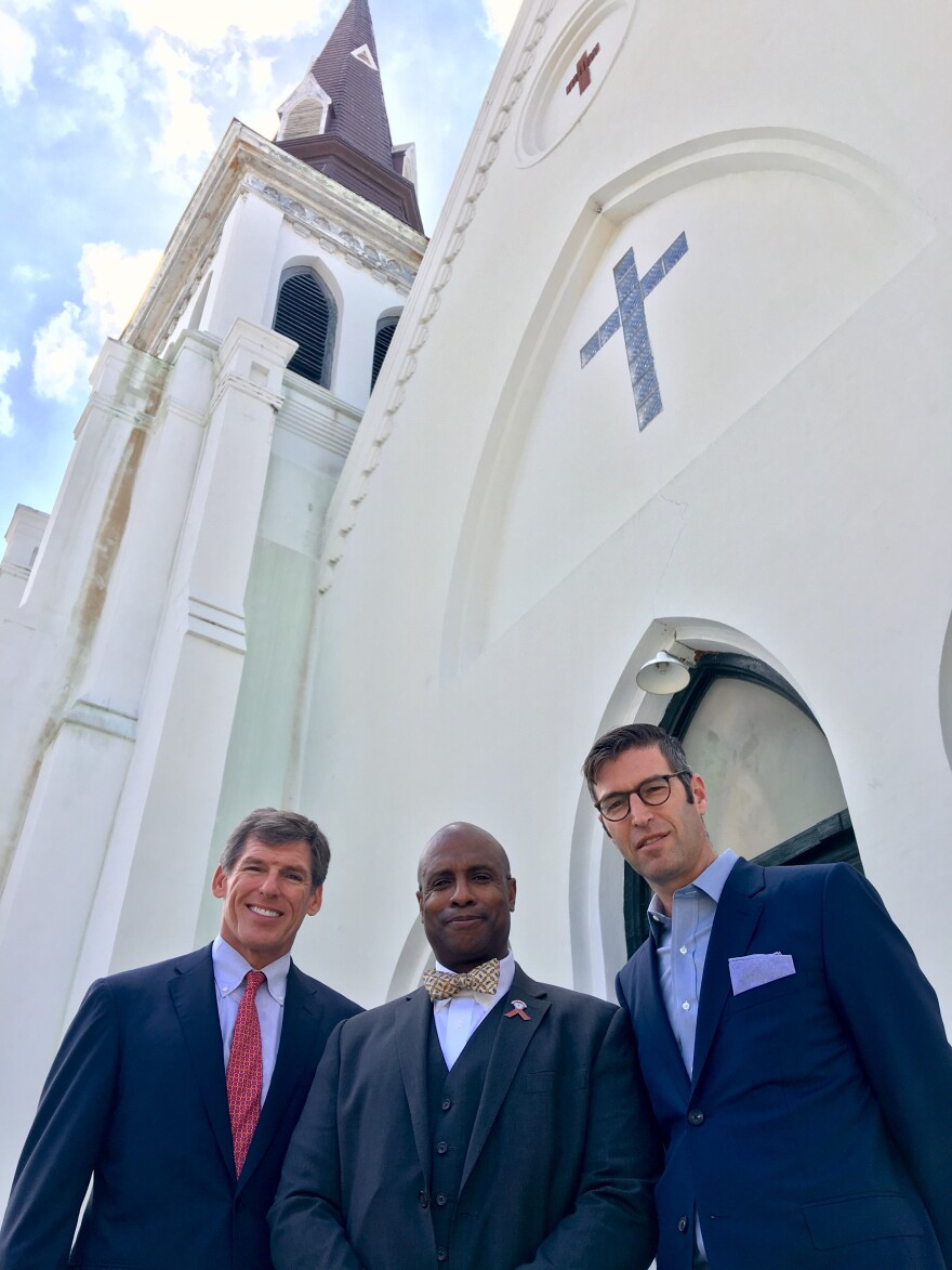 Left to Right: John Darby (co-chair of the memorial's executive committee), Rev. Eric SC Manning (Pastor of Emanuel AME Church), Michael Arad (memorial's architect with Handel Architects) in front of Emanuel AME Church.
