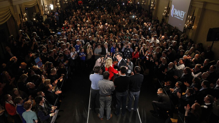 Republican presidential candidate, former Massachusetts Gov. Mitt Romney is the center of attention at rally in Des Moines, Iowa, Tuesday.
