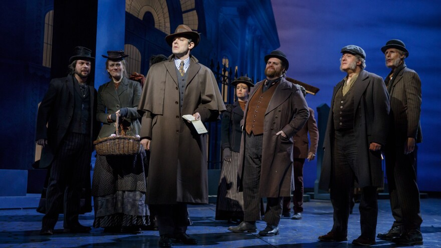 In the recent production of <em>My Fair Lady</em>, Broadway veteran John Treacy Egan (bearded, just right of center) plays a number of roles within the chorus, including a singing street vendor.