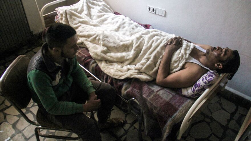 Hassan Youssef, a 40-year-old victim of the April 4 chemical attack in Khan Shaykun, receives medical care in a hospital in the nearby Syrian city of Idlib on Thursday.