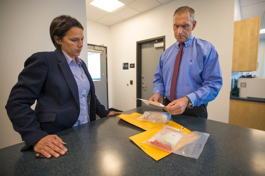 Arlington, Mass., Police Chief Fred Ryan (right) and Inspector Gina Bassett review toxicology reports on cocaine evidence looking for the possibility of fentanyl.