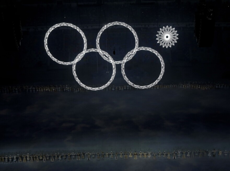 A technical glitch kept one of the massive Olympic rings looming over the stadium dark during the opening ceremony of the 2014 Winter Olympics in Sochi, Russia, on Friday.