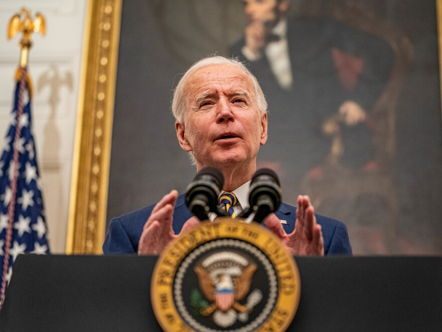 U.S. President Joe Biden speaks on his administrations response to the economic crisis in the State Dining Room of the White House in Washington, D.C., U.S., on Friday, Jan. 22, 2021.
