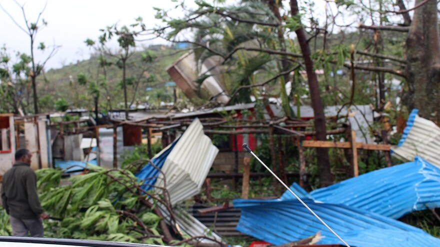 Roofing and other debris is scattered over a building in Port Vila, Vanuatu, on Saturday the aftermath of Cyclone Pam.