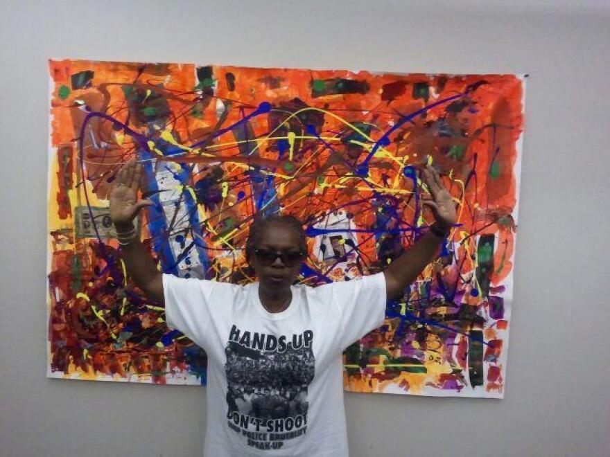 "Salon 53 gallery owner Freida Wheaton's ""Hands Up"" response"