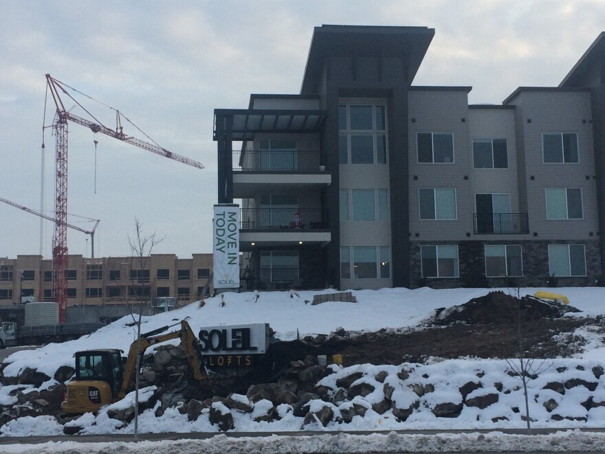 Photo of apartments under construction in snow.