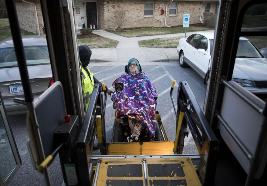 Ananda Bennett, a 30-year-old quadriplegic heads out for a rare evening out traveling on Greensboro Transit Authority (GTA) Specialized Community Area Transportation (SCAT) that provides transportation for persons with disabilities in Greensboro, N.C.