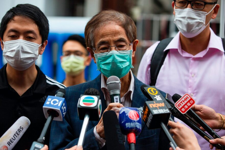 Former lawmaker and pro-democracy activist Martin Lee (C) talks to members of the media as he leaves the Central District police station in Hong Kong after being arrested and accused of organising and taking part in an unlawful assembly in August last year.
