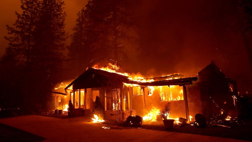 A home burns as the Camp Fire moves through the area on Thursday in Paradise, Calif. Fueled by high winds and low humidity, the rapidly spreading Camp Fire has ripped through the town of Paradise.