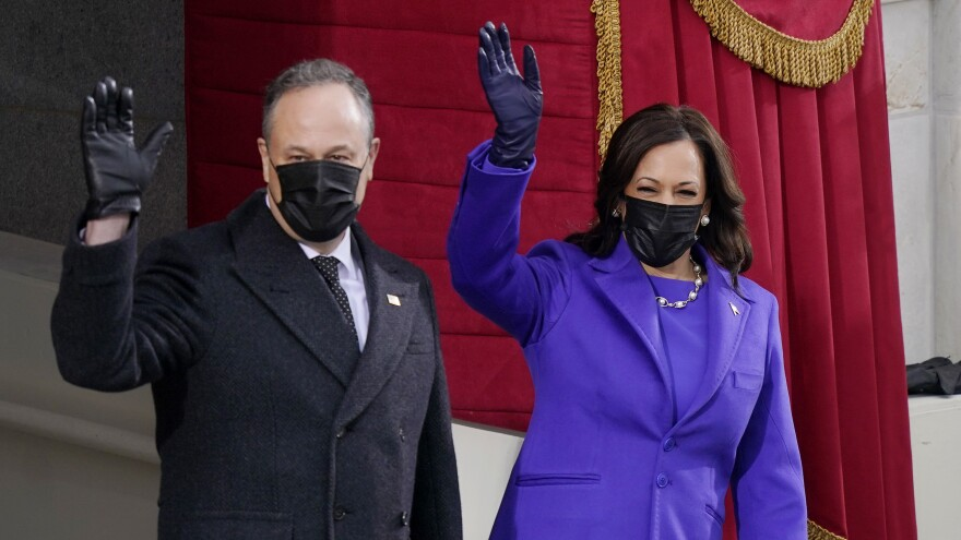 Vice President-elect Kamala Harris and husband Doug Emhoff arrive to the inauguration on the West Front of the U.S. Capitol on Wednesday.