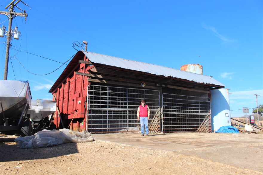 Barry Capps stands in front of a wooden shed that, at the time, held between 25 and 30 tons of ammonium nitrate.