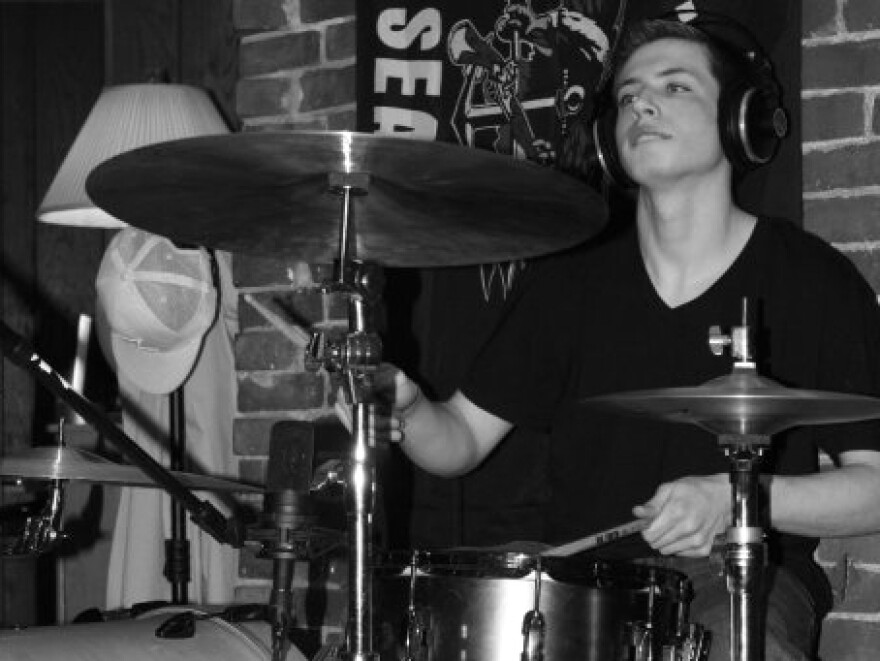 "Max at his drum kit. Playing the drums was Max's passion, his family says, as was ""creating original music, listening to jazz, rock, and blues, shooting pool, following the Red Sox and Patriots, playing fantasy football with his family, and enjoying card games and chess."""