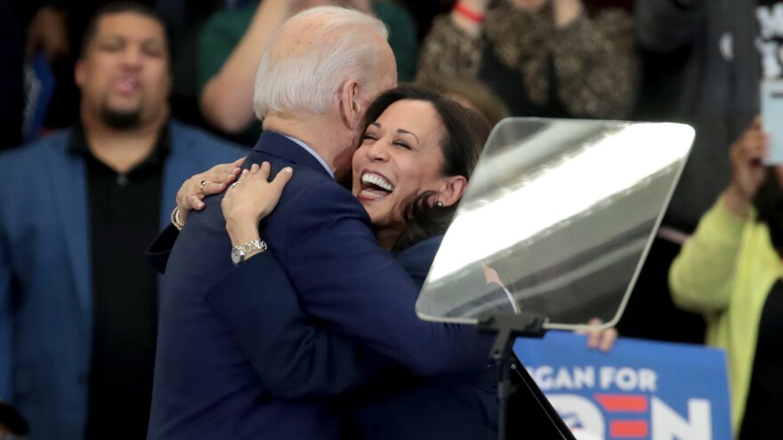 Biden and Harris embrace after she endorsed and introduced him at a March 9 campaign rally in Detroit.