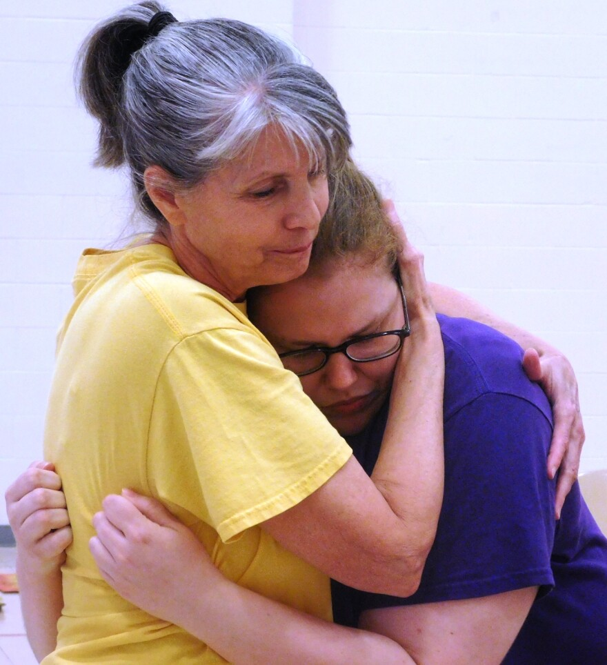 June 12 photo. Patty Prewitt, left, comforts Tessa Van Vlerah in the play Run-On Sentence in the Prison Performing Arts production at the Women's Eastern Reception, Diagnostic and Correctional Center.