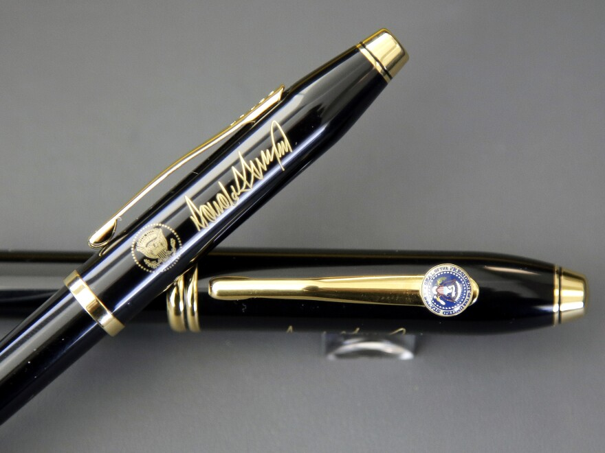 A.T. Cross Co. custom-made pens, designed for President Donald Trump, feature his signature and presidential seals.