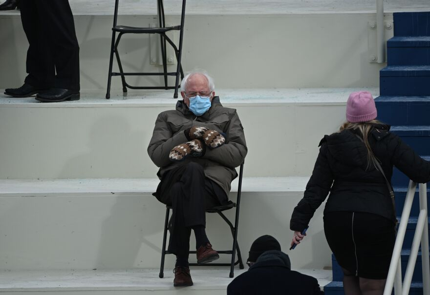 Sen. Bernie Sanders (I-Vt.), a former presidential candidate, looks toasty in the bleachers on Capitol Hill before Joe Biden is sworn in as the 46th president.