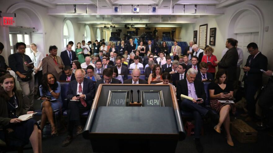 Reporters wait in the James Brady Press Briefing Room at the White House on June 23, 2017.
