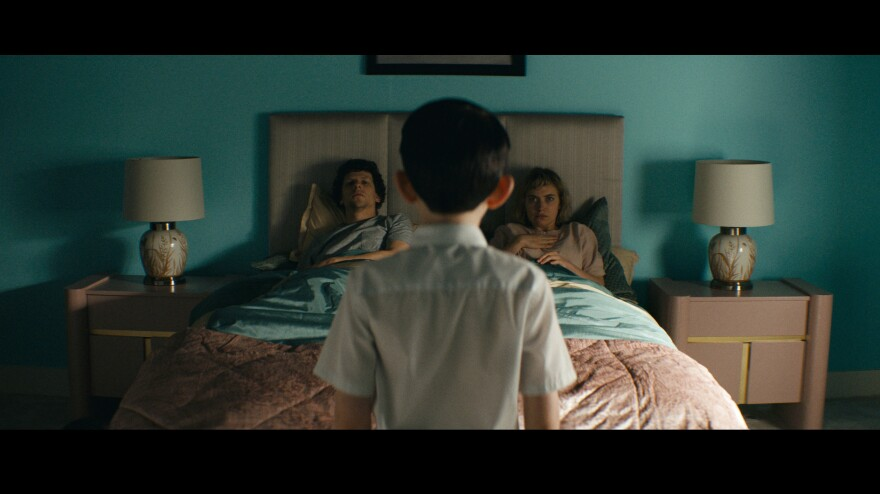 Tom (Jesse Eisenberg) and Gemma (Imogen Poots) go house hunting and find something more in <em>Vivarium</em>.