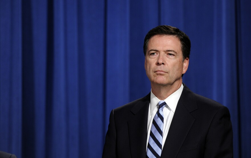 James Comey at a news conference in 2014. On Thursday, Comey is expected to tell Congress that, yes, he did tell President Trump he wasn't under investigation — but that Trump also asked him not to pursue investigating Michael Flynn.